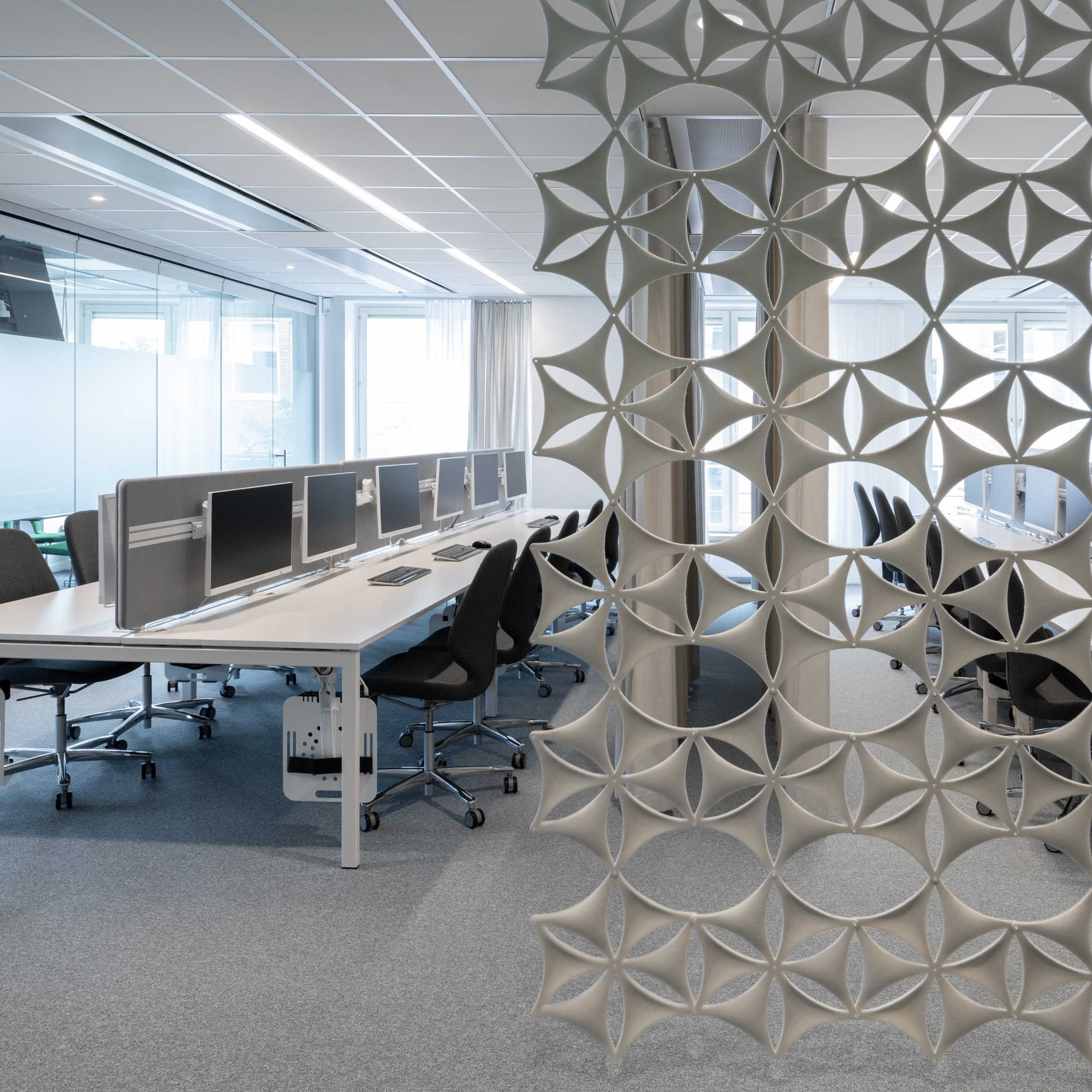 acoustic screen installed in a large office space - john atkinson interiors and acoustics